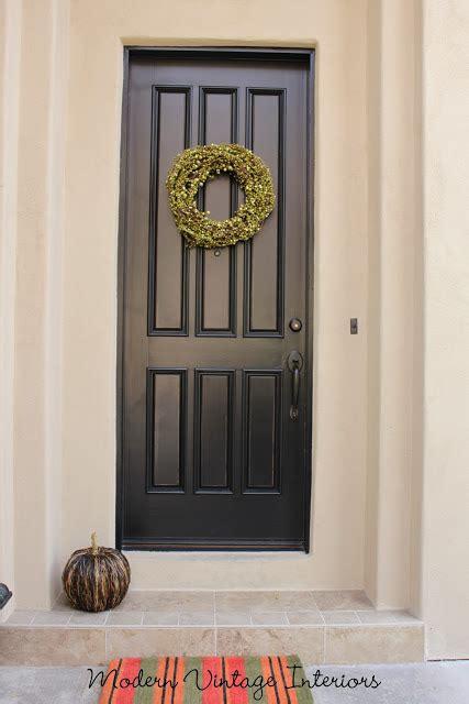 remodelaholic painting  wooden exterior door black