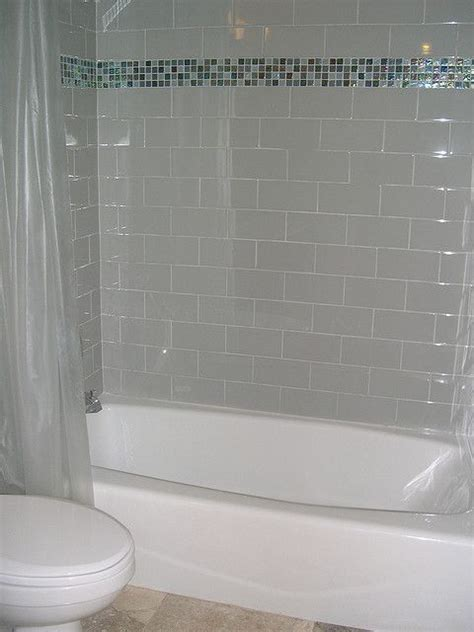 subway tile  glass border bathroom design small tub