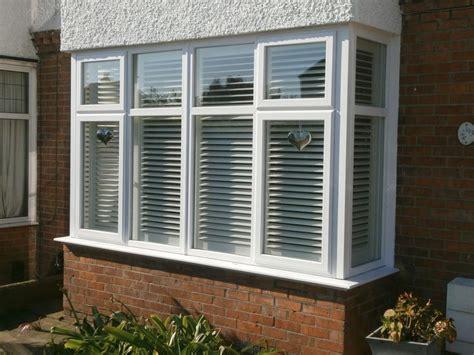 exterior view  box bay window plantation shutters