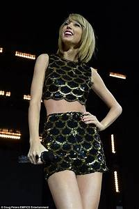 Taylor Swift in red dress at Jingle Bell Ball before tiny ...