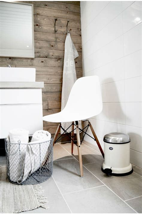 How To Decorate A Small Bathroom With A White Chair?