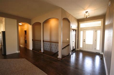 Open Staircase To Basement Altoona Custom Ranch By Mj