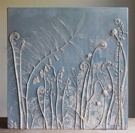 artist creates flower fossils  casting plants  plaster