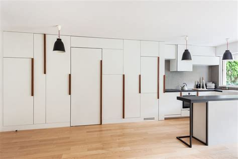 Minimalist Small Apartment with Hidden Bedroom and Storage
