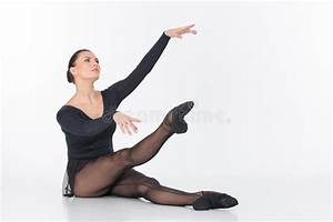 ballet dancer sitting on floor and stretching stock photo With dance where you sit on the floor