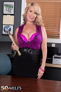Blond mature in solo action