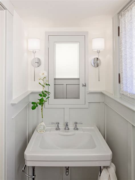 ivory and gray powder room design with gray medicine