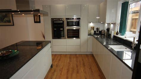 white gloss kitchen  black granite worktops worcester diamond kitchens driotwich