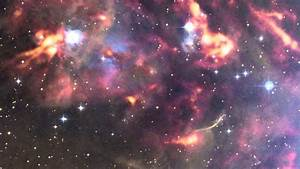 Clouds of Cosmic Dust Glow Near the Orion Nebula
