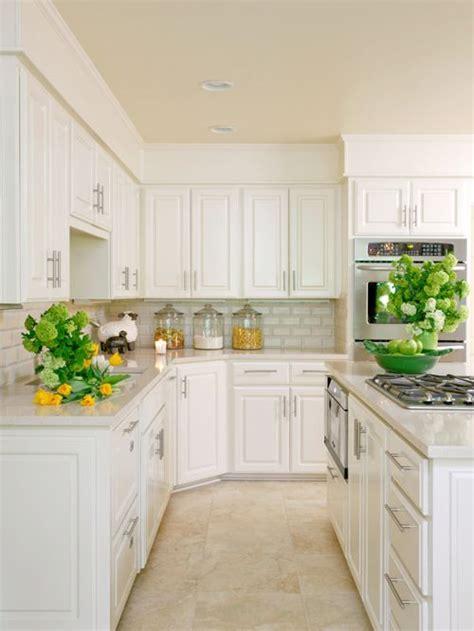 white kitchen travertine floor travertine flooring with white cabinets houzz 1415