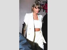 Taylor Swift shows off taut tummy in a white crop top as