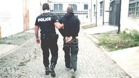 Criminal Arrest Stock Photo - Download Image Now - iStock