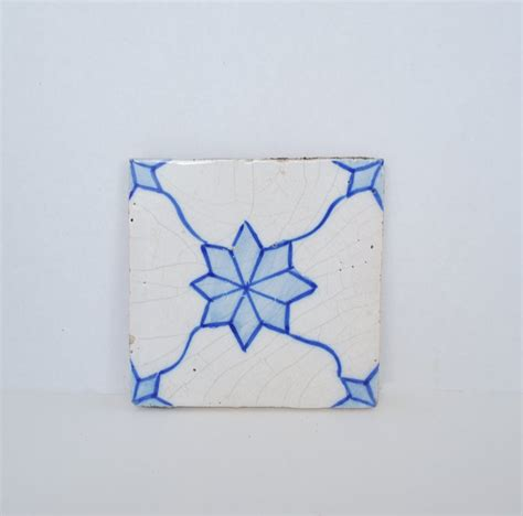painted blue and white vintage decorative tile just