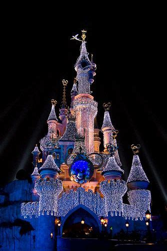 Sleeping beauty Castle at night with Christmas lights