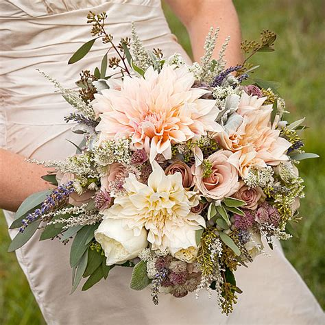 A Rustic Romantic Bouquet Of Dahlias And Roses Tying The