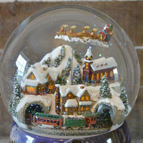 large snow globes christmas large flying santa musical snow globe barretts of woodbridge