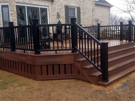 black porch railing composite deck w skirting and black railing hearth and