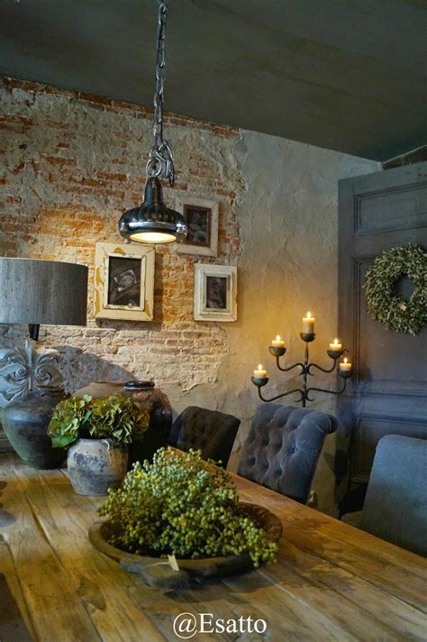 the exposed brick and rustic farm table with