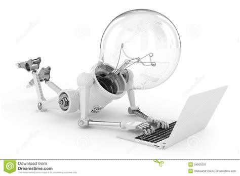 robot lamp working   laptop stock image image