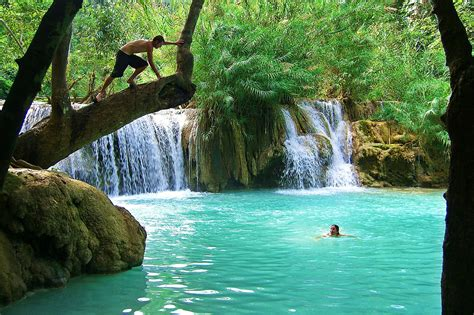 Kuang Si Falls | A backpacker prepares to leap into the ...