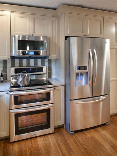 neutral kitchen cabinets  stainless steel refrigerator