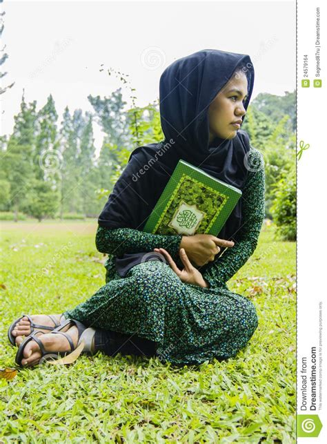 Indonesian Moslim Girl With A Quran Stock Images - Image