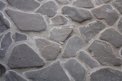 rock floor tile grouting a diy beach stone floor merrypad