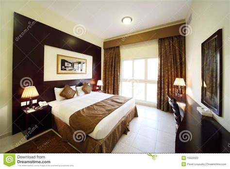 bedroom with opened curtain big bed stock photo