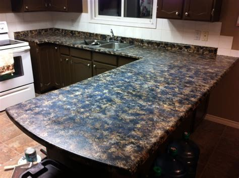DIY faux granite countertops. Acrylic paint and a sea