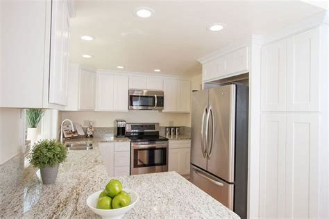 kitchen with cabinets and light granite giallo ornamental light granite decoratingspecial 9851