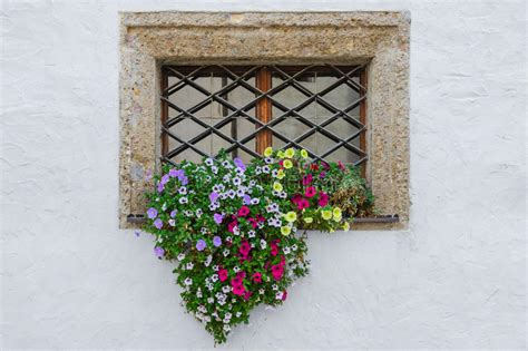 Exterior Window Sill Stock by Colorful Flowers On Window Exterior Of European House