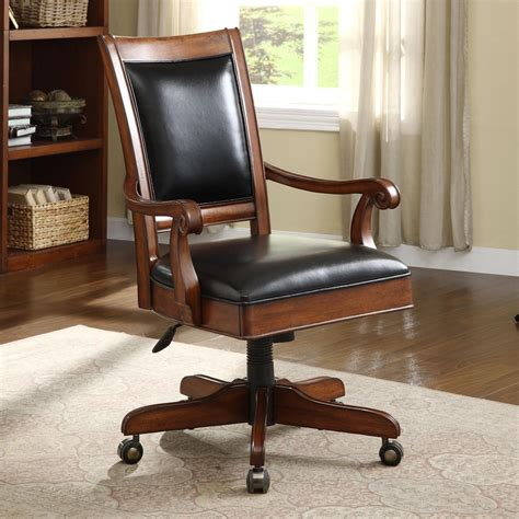 caster equipped wooden desk chair with leather covered