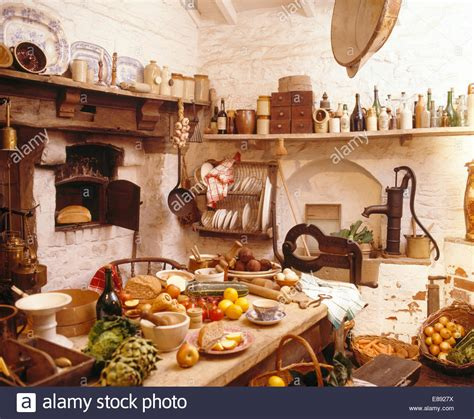 Table Laden With Food In Cluttered Old Fashioned Kitchen. Kitchen Renovation Quotes. Vintage Kitchen Wall Colors. Kitchen Island Vent Pipe. Nook Kitchen Menu. Kitchen Island With Shelves On End. Kitchen Hardware Houzz. Yellow Kitchen Shelves. Wood Kitchen Nook