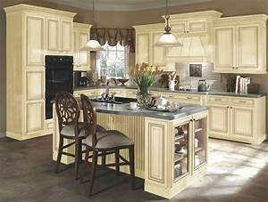 Kitchen idea #3: distressed cream cabinets, this has tile