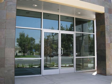 mission style wall storefront glass door repair manchester lock security