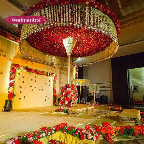 Grand Wedding Decorations - a grand stage decorated with a canopy of flowers