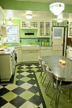 Fabulous green kitchen. Love the glass front cabinets, the
