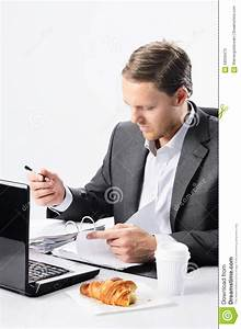 Hardworking Man In Suit With Half Eaten Croissant Stock ...
