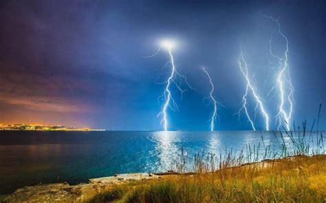 nature landscape lightning coast sea clouds
