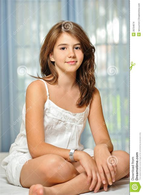 beautiful teen girl  home  white dress stock