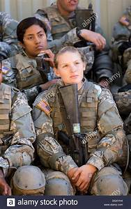 Female soldiers at basic combat training listen to ...