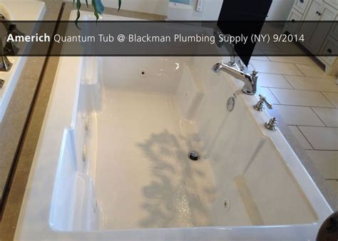 Americh Quantum Tub @ Blackman Plumbing Supply (ny)  9. Gray Kitchen Cabinets. Nesting Coffee Table. Mid Century Room Divider. Wooden Armoire. King Tufted Headboard. Home Bar. Peacock Pavers. 40 Gas Range