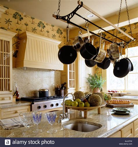 kitchen  marble top surface  saucepans hung