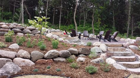 boulders for retaining wall retaining boulder walls northland landscape construction inc