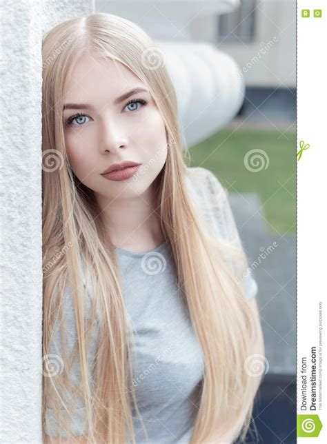 Cute Blond Girl With Blue Eyes Stock Photography