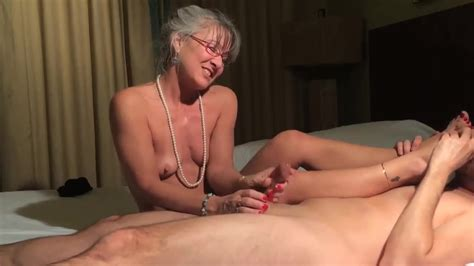 Bitchy Granny Gives Handjob And Finishes With Footjob Feet9