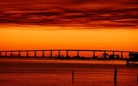 fusion naranja sobre cielo tintado versos fotografias