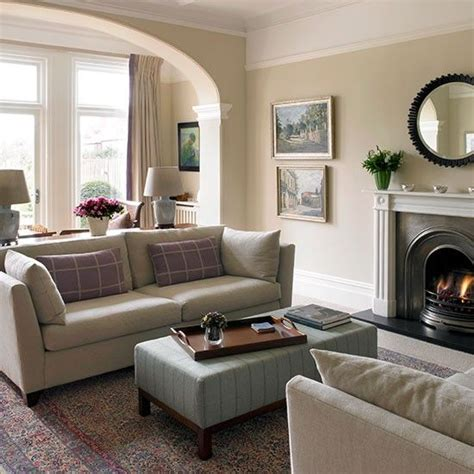 traditional cream living room with arch living rooms