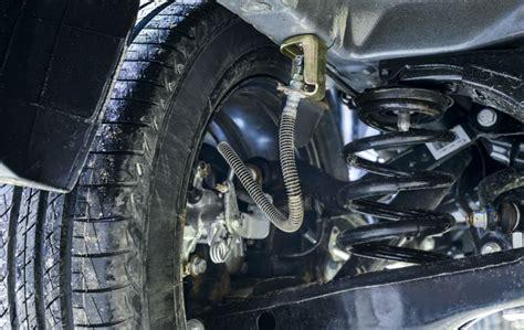 suspension spring replacement costs repairs autoguru