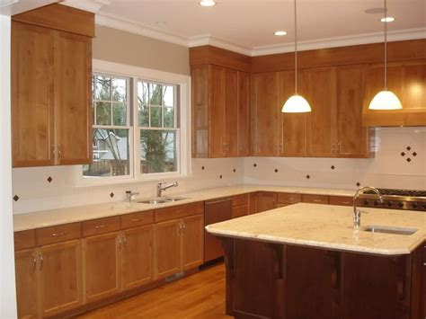 kitchen soffits wrapped in thin plywood with crown molding